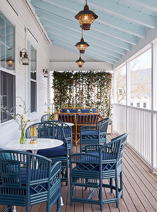 This season the restaurant will seat lunch and dinner guests on the covered side porch. The bamboo furniture gets a modern makeover in bright blue, one of the hero colors throughout the property.