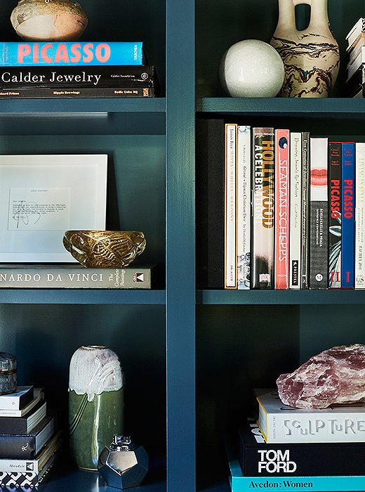 Painted Farrow & Ball's Hague Blue but backed by the same Inchyra Blue as the walls, the built-in shelves in Jennifer's office help corral her enviable collection of art books and pottery, interspersed with near-and-dear pictures of family, paintings by her adored artist grandmother, and other curios that invite a closer look.