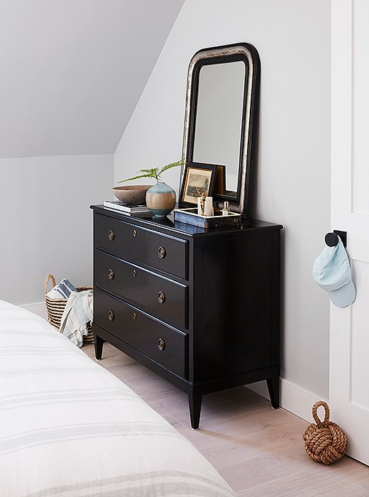 An antique mirror adds weight and character to a dresser designed by One Kings Lane.