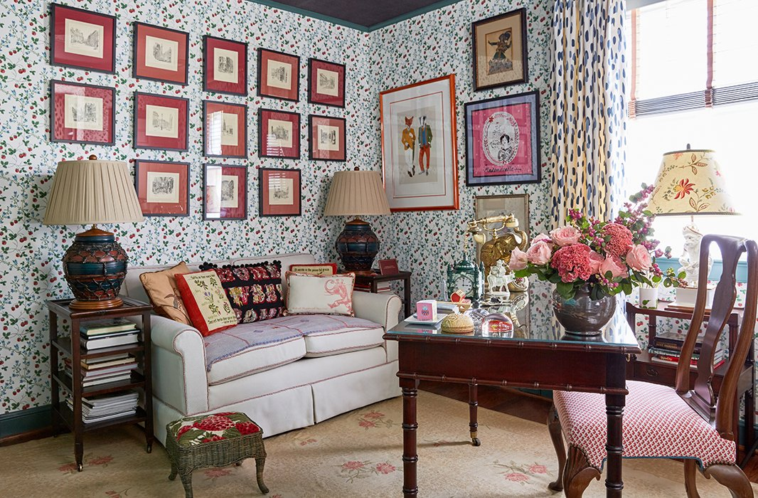 Coordinating artwork in matching frames and mats makes a graphic statement—even on top of heavily patterned wallpaper. Photo byTony Vu.