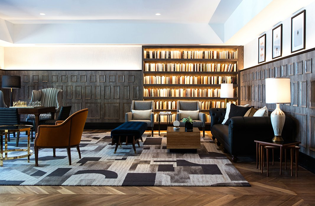 The lobby at the Kimpton Mason & Rook Hotel, complete with well-stocked bookshelves and a cozy library vibe. Photo courtesy of Mason & Rook.