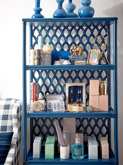 A blue bookshelf puts a graphic spin on coastal style—and houses an ever-changing assortment of gifts and decor.