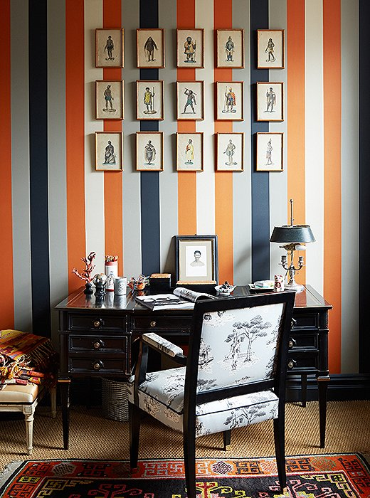 Sheila's never met a stripe she didn't like, and she used one of her own design for this wallpaper. The chair is upholstered in her Harlem Toile pattern, which is in the collection of New York's Cooper Hewitt, Smithsonian Design Museum.