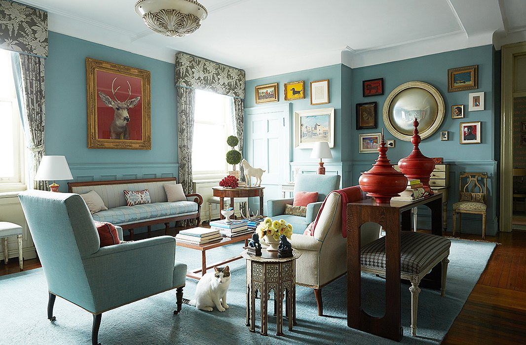 While The Living Rooms Layout Is High Traditionalism With A Formal Seating Arrangement Complete