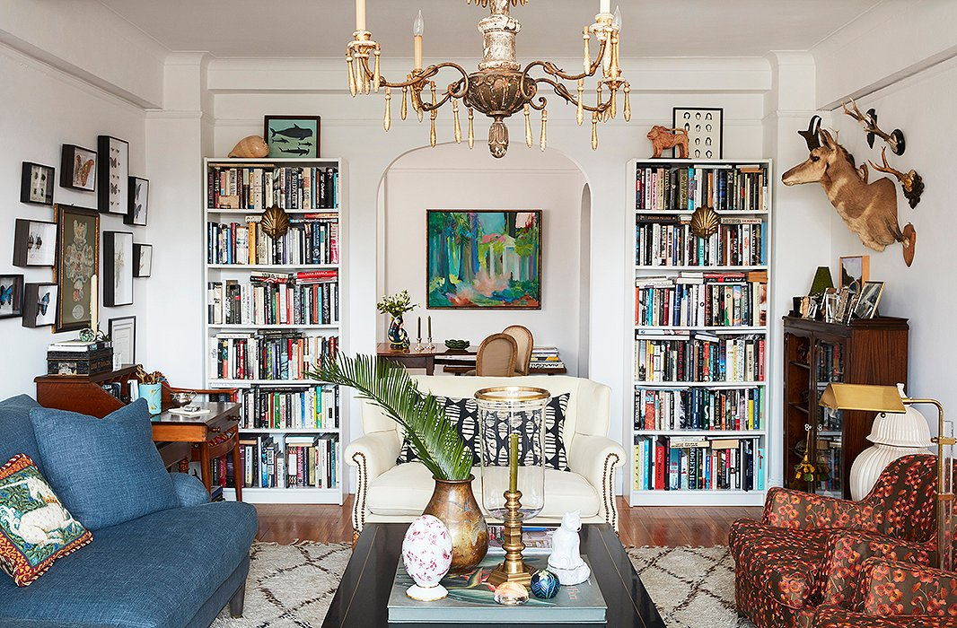 """I hate shopping,"" says Matt, ""and I don't like to be in a store for more than 15 minutes… I don't like to browse, either, except in old used bookstores."" On either side of the living room's arched opening, bookshelves brim with the couple's finds."