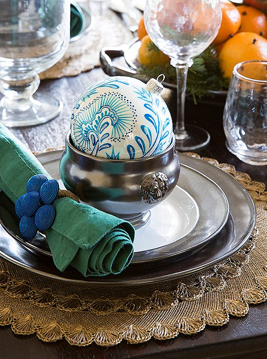 "Eileen accented the dining room's blue-and-white scheme with pewter, not silver, for an elegant yet approachable look. ""The matte finish of pewter makes the setup feel a little more modern and laid-back,"" she says."