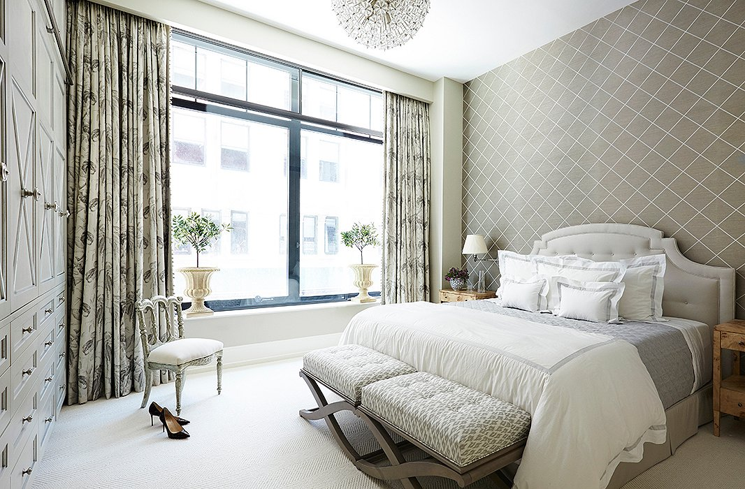 A soothing palette of neutrals turns the bedroom into a true retreat.