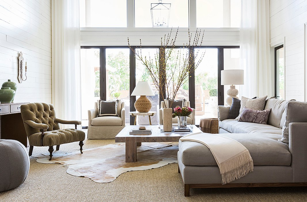 The home's large lot allowed Marie and her team to close off part of the back patio, creating a new double-height family room. Find similar hide rugs here. Photo by Julie Soefer.