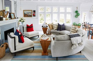 Attirant A Circular Sectional And Zebrawood Side Tables Add A Cosmopolitan Touch To  The Seaside Vibe.