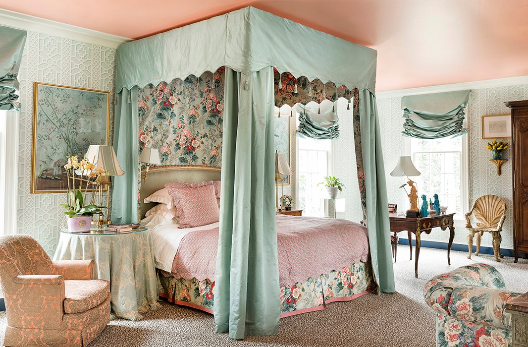 In the master bedroom, which is wrapped in Schumacher's Zanzibar Trellis paper, Danielle crafted the bed of her dreams with satin canopy lined in Lee Jofa chintz.