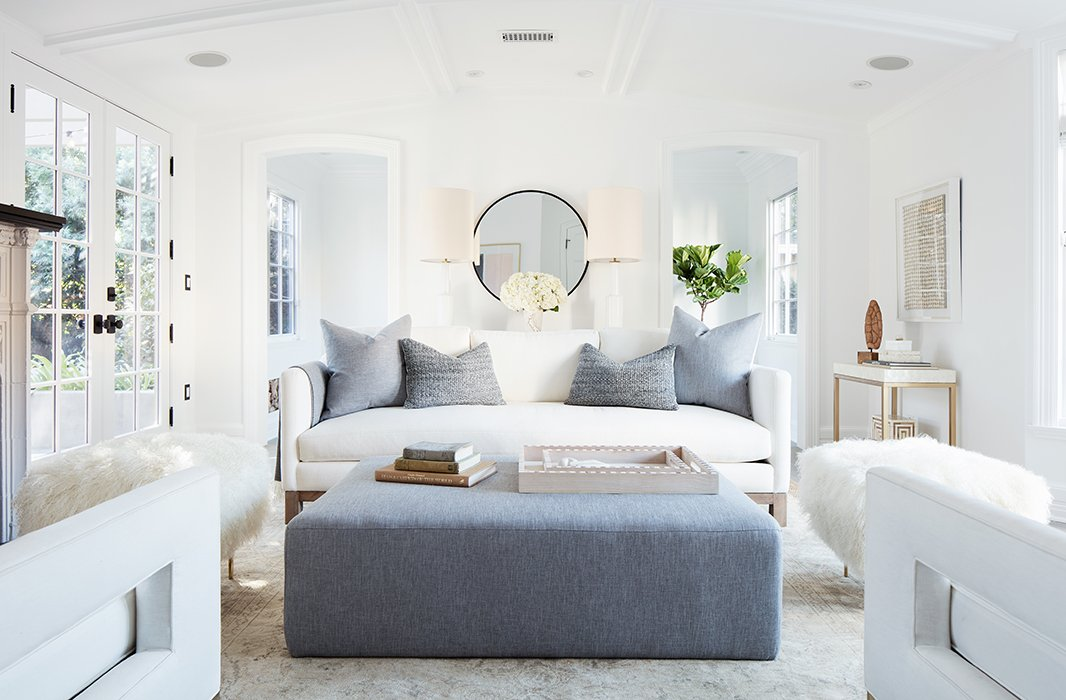 """""""I wanted every wall to make sense, to have its own vignette,"""" says Alex. It's also a flexible design scheme—the ottoman adds extra seating and can be """"scooched up for cozier conversations during parties."""""""