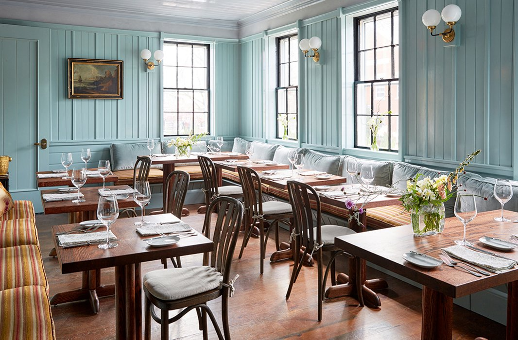 The dining room's sea-blue walls lend it a modern New England tavern feel. The menu from executive chef Marcus Gleadow-Ware, an alum of Charlie Palmer's Michelin-starred Aureole, reflects the same sensibility, incorporating local organic produce from landscape designer Marty McGowan's Pumpkin Pond Farm.