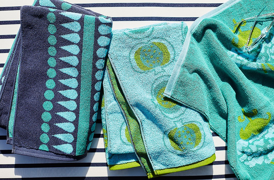 Beach towels designed by Katie Ridder become an electric finishing touch (view them all here).