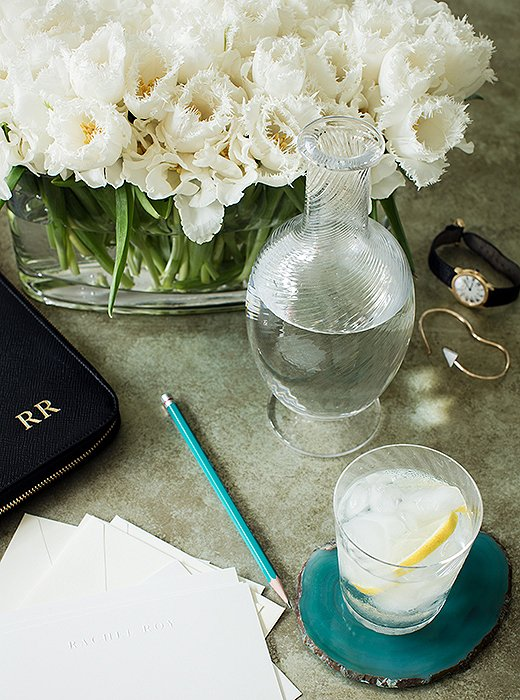 """Agate coasters, another One Kings Lane find, add totheturquoise notesin Rachel's office. """"I like pops of color but ones that blend as opposed to standing out,"""" she says. """"And I'm currently in love with fringed tulips."""""""