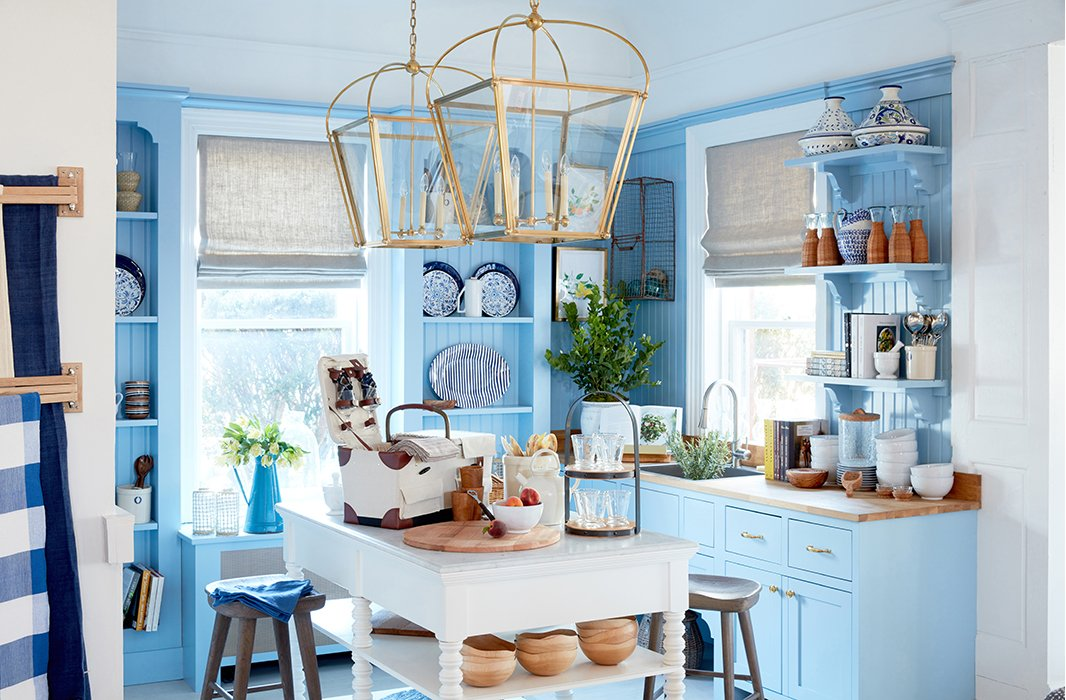 The kitchen of the Southampton shop feels fresh yet cozy in allover blue. Design by Sarah Blank.