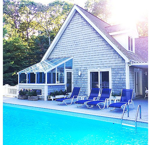 Ana's favorite Airbnb in East Hampton boasts a relaxation-ready pool and a dreamy sunroom. Photo by @ananewyork.