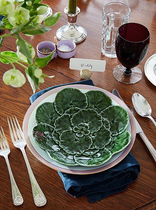 "Place settings with Bordallo Pinheiro lettuceware, colorful glass, and silver utensils picked up in a Parisian market represent a mix that's ideal for parties but casual enough for everyday. ""My parents were always having people over,"" Bobby says. ""Whether it was dinner or cocktails, crawfish or steak, they had a knack for making things comfortable, not stuffy."""