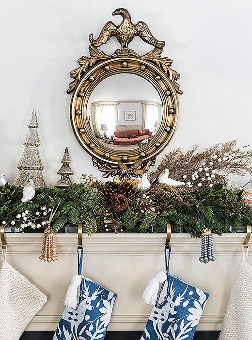 Stylish pearl tassels complement Otomi-inspired stockings on the family room mantel.