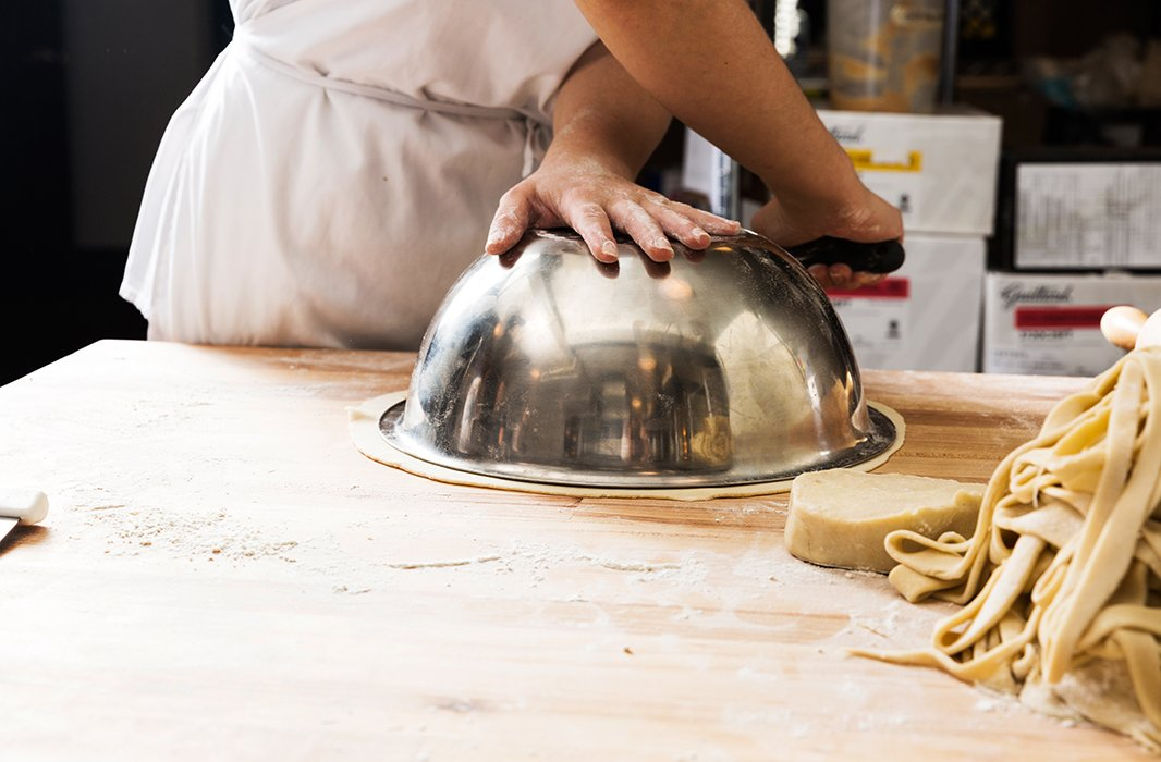 In the Four & Twenty Blackbirds kitchen, bakers use a bowl to make sure the crust is rolled out to be 2-3 inches larger than the pie pan. You can also flip your pie pan over and use that.