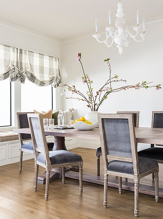 The team added a built-in window bench to maximize seating in the sunny breakfast nook. Photo by Julie Soefer.