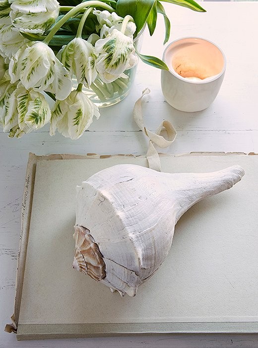 A tea light, a seashell, and a notebook jotted with ideas: These are things Foley loves.