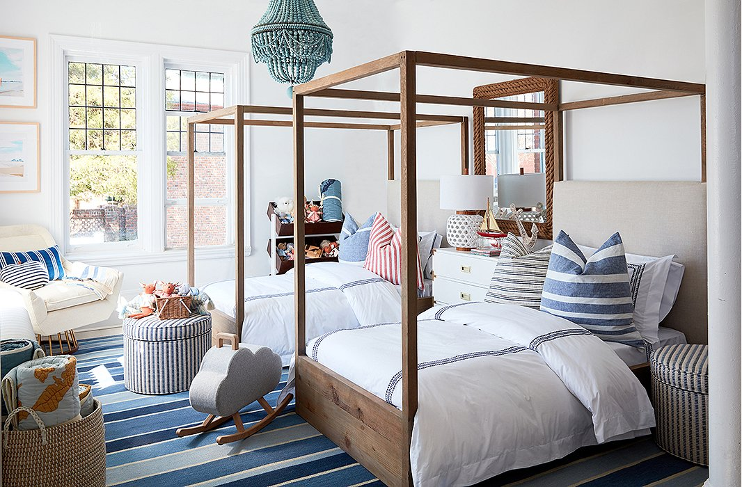 You can never go wrong with a classic stripe. We decked out the store's bedroom nook with a bold blue-and-white rug, crisp bedding, and cushy pillows by Hedgehouse.