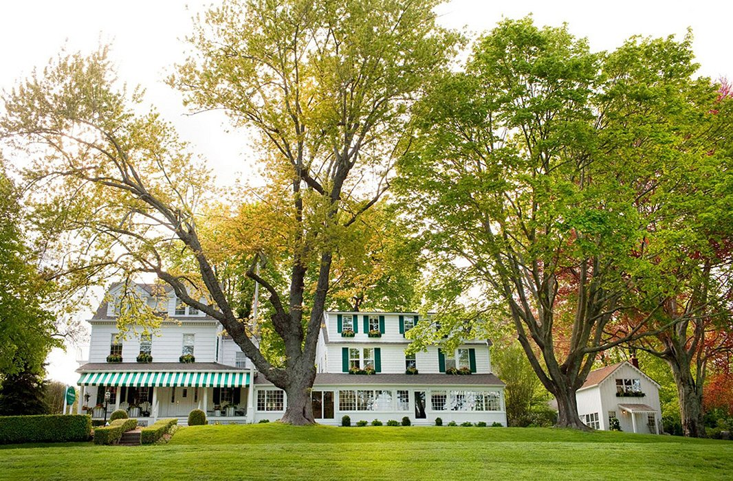 Green-and-white striped awnings enhance the Maidstone Hotel's classic charm. Photo courtesy of the Maidstone Hotel.