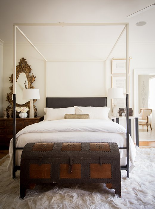 Timeless French Decorating Ideas {Tara Shaw}. The trunk at the foot of the master bed is another treasure from Italy: Covered in velvet and nail heads, with its original toile, it provides lots of storage. I can open that trunk and there goes everything I want to hide.The cozy long-haired rug is balanced by the high-gloss car lacquer of the bed frame.