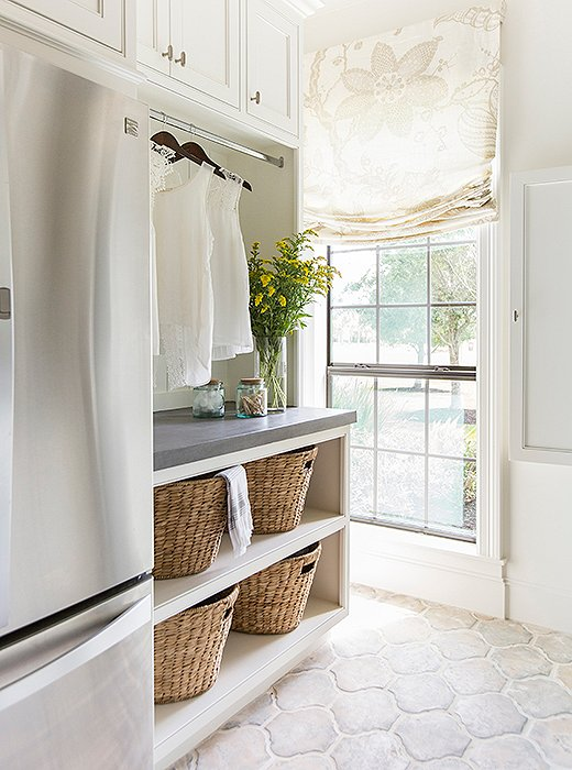 The laundry room doubles as a mudroom, with plenty of storage to accommodate a growing family. Photo by Julie Soefer.