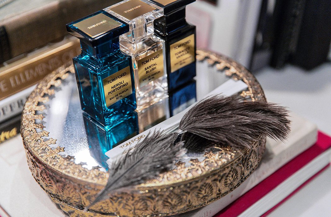 Ornately trimmed mirrored trays are used throughout the atelier for glimmering displays, as in this collection of perfumes by Tom Ford, and to hold guests' beauty picks.