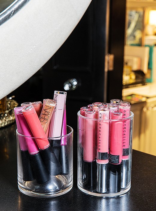 Featured lip glosses by Nars and Olivia Chantecaille in lush pinks and purples are always at the ready on a counter for a vibrant perk-up.