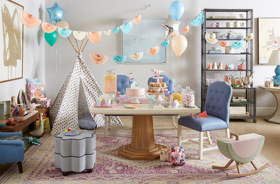 We stuck to a pastel palette to complement the tones of the Georgica Table and Jack Chairs, both by Bunny Williams Home. In a corner, a patterned tepee offers a perfect place to hide and play. And instead of surrounding the table with dining chairs, we added an ottoman, a children's-size chair, and a rocker into the mix so that everyone has a comfy spot to perch.
