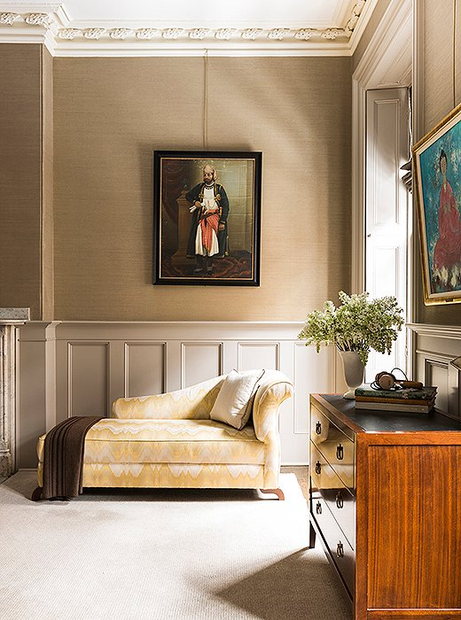 The subtle curve on the arm of this chaise brings a quiet allure to a bedroom corner. Photo by Lesley Unruh.