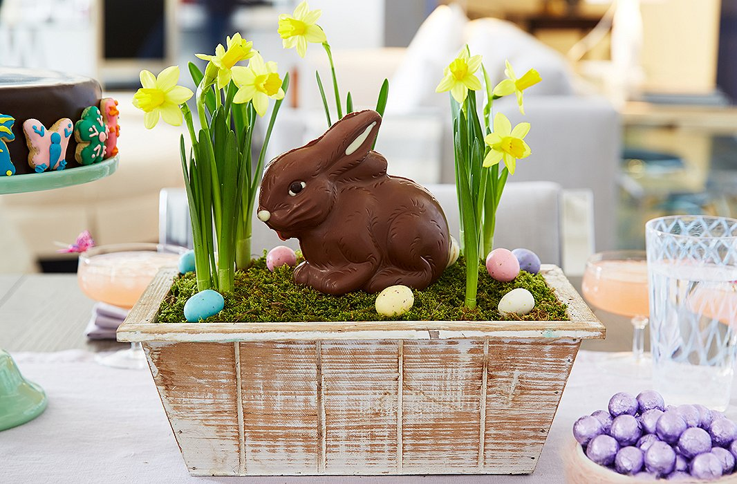 Bring the outdoors in with this whimsical DIY centerpiece. Modeled after a window box, it incorporates blooming daffodils and—what else?—a charming chocolate Easter bunny.