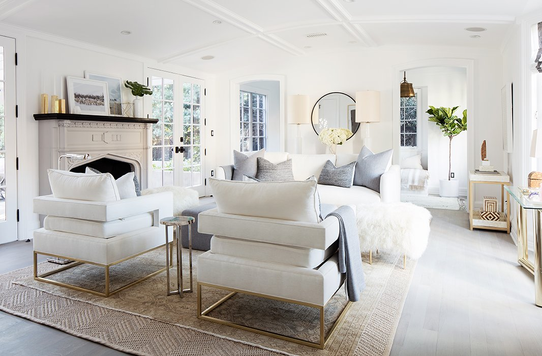 """The club chairs, Alex says, """"have a great architectural line and a sexy cut from the back,"""" making them idealfor a central seating arrangement."""