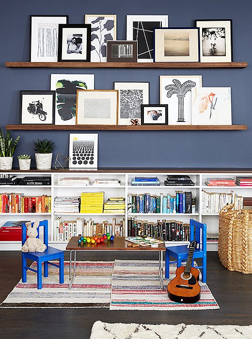 A pair of shallow shelves offer up an easy, casual way to show off your art collection. Photo by Manuel Rodriguez.