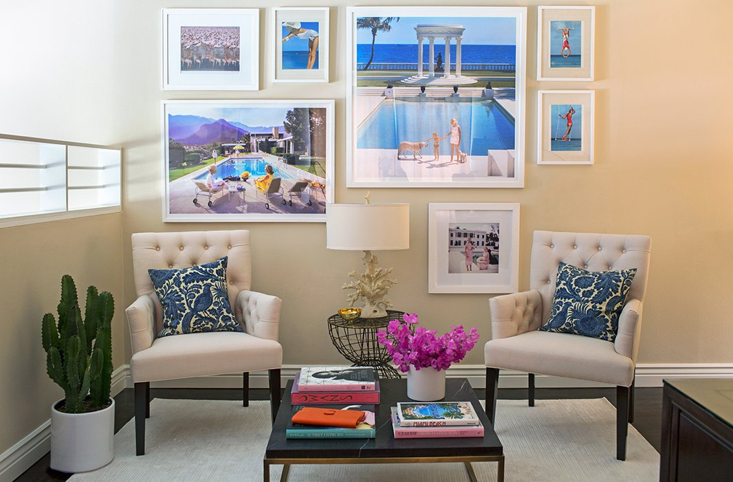 "Louise carved out a comfy seating area that's perfect for business meetings as well as for friends who often drop in during the day. (""My work life is very not a routine."") Slim Aarons photographs, which Louise collects, were the jumping-off point for the office's coastal theme."