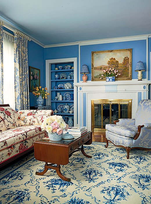 A shade of blue lends a sense of unity to a richly layered living room.