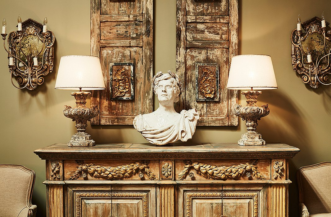 A handsome classical bust rests atop a carved-wood sideboard. Melissa is drawn to pieces with patina: layers of paint, faded gilding, timeworn textures.