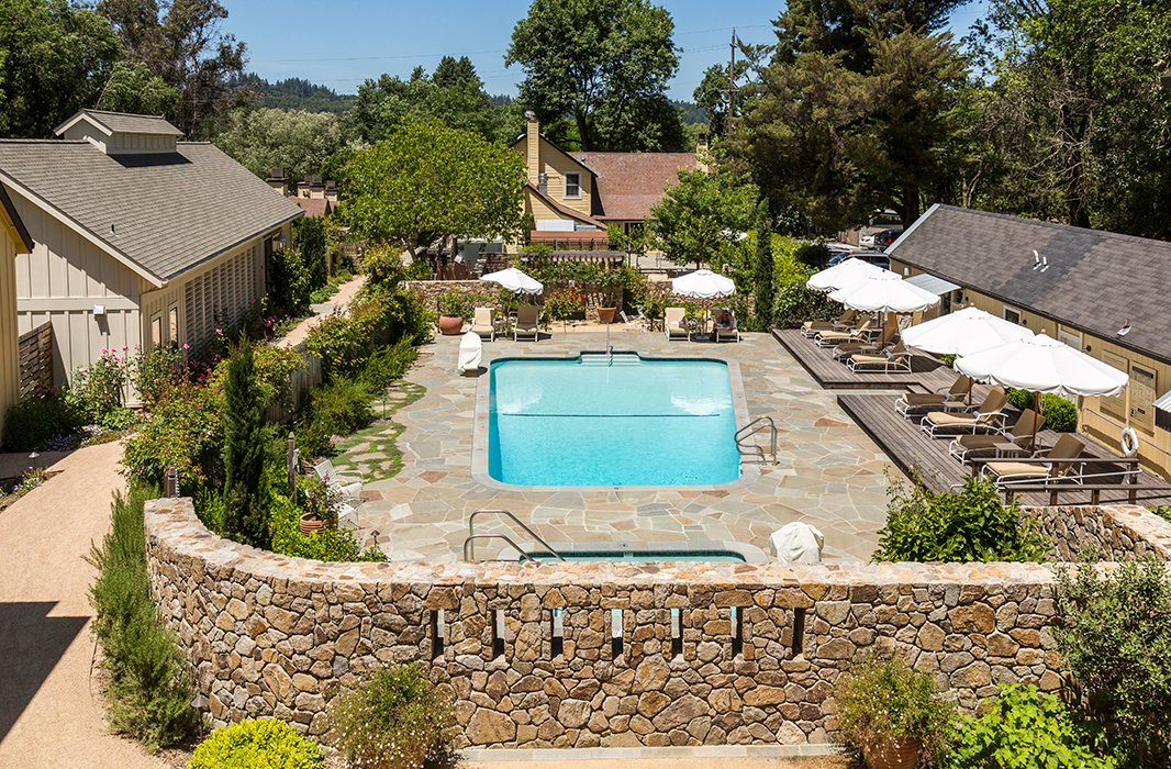 Grounds at the inn, which include a heated pool and a hot tub, are covered in lavender, hydrangeas, indigenous rhododendrons, and fragrant roses from the Russian River Rose Company.