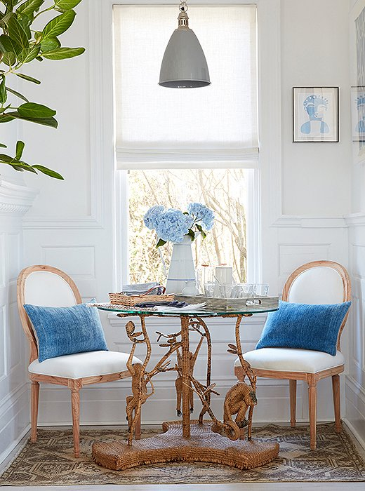 A vintage table anchors a sunny dining nook. The artwork is by One Kings Lane favorite Hayley Mitchell.