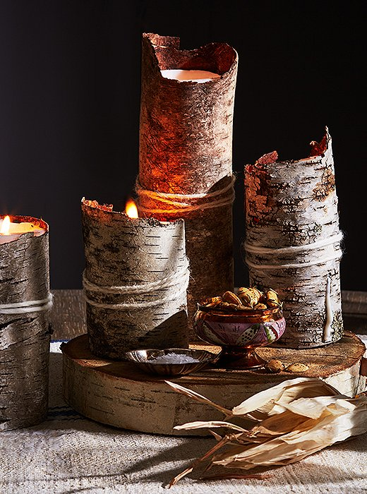 A white pillar candle, birch-bark sheets, and a piece of yarn are all you need to bring a rustic glow to your table.