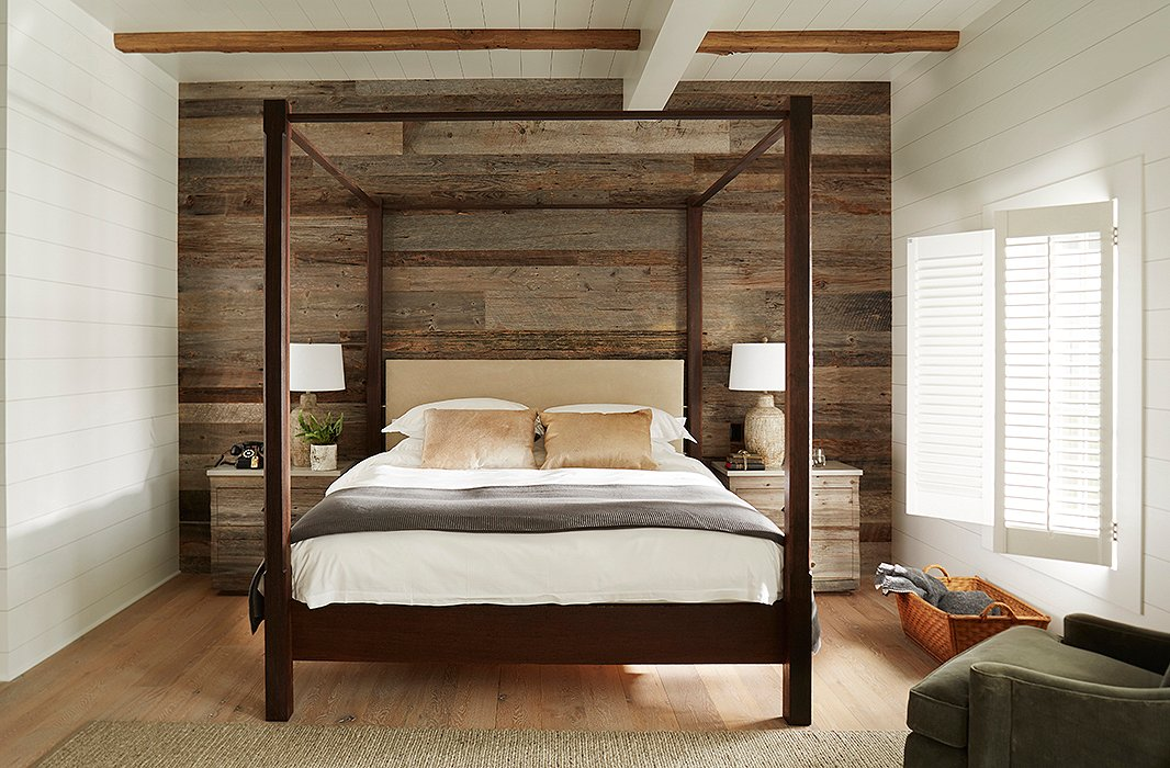 Bedrooms feature walls covered in shiplap and reclaimed wood along with king-size canopy beds and side tables crafted by local artisans. Rotary phones provide a nod to the past.
