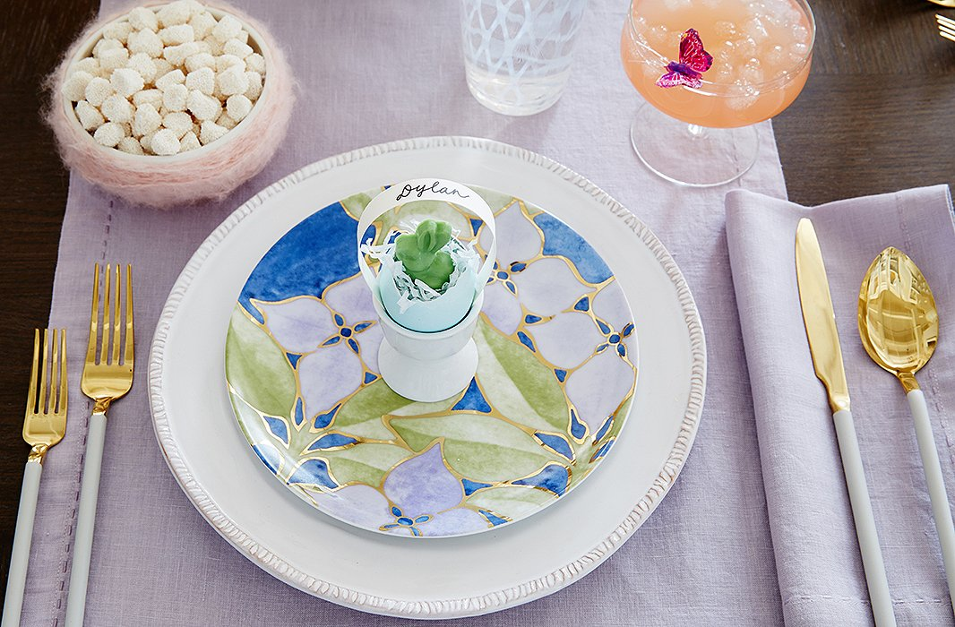 Dylan's Easter table includes pastel linens for a fresh, airy vibe, along with sparkling glassware and dishes in springtime motifs.