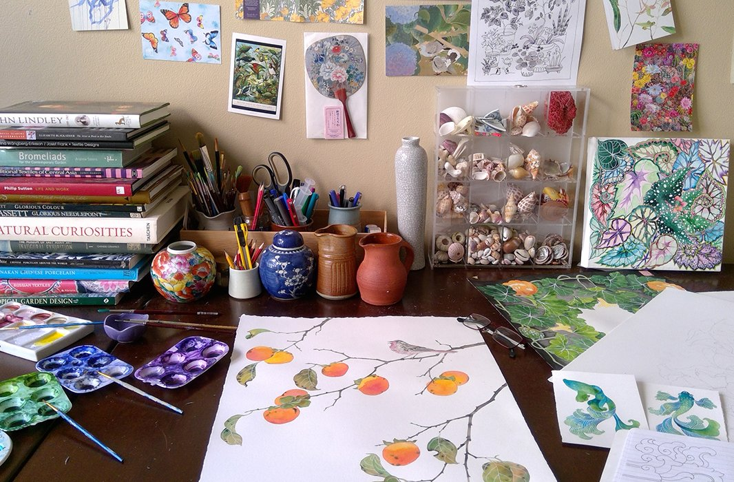 Gabby's worktable brims with collected inspiration, including gardening books, ceramics, shells, and postcards. Photo courtesy of Gabby Malpas.