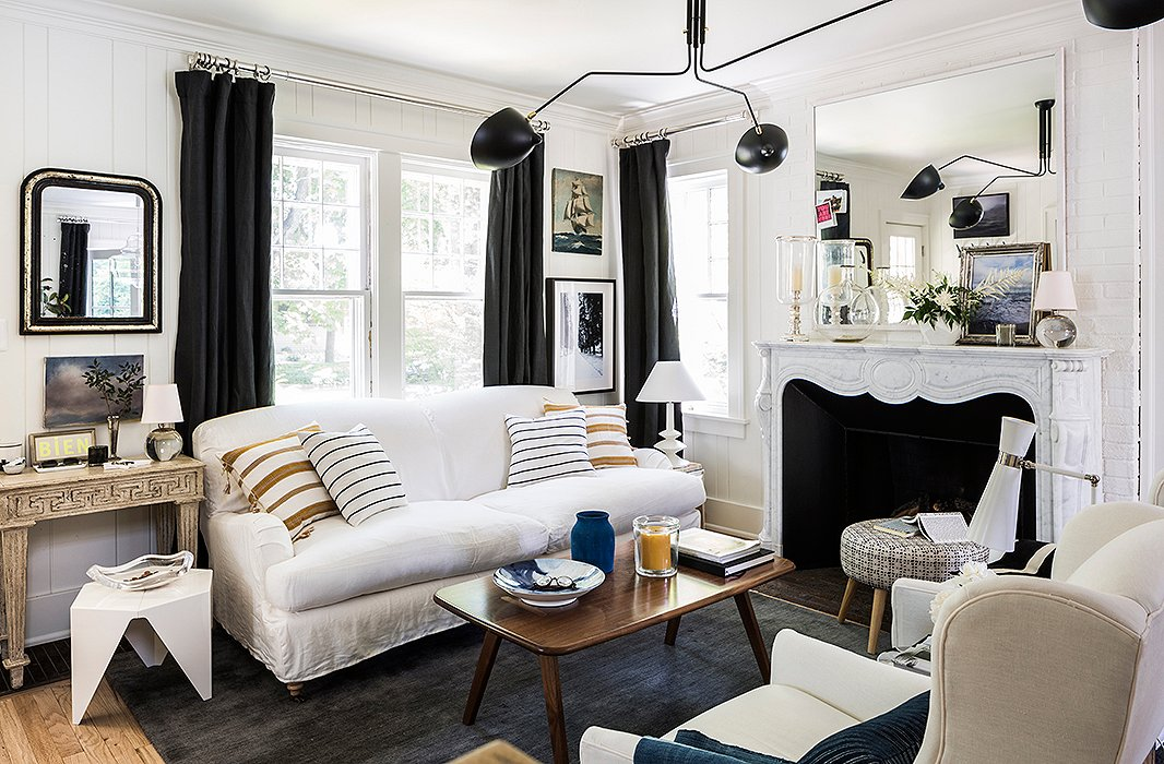 As this room shows, black and white plays just as well with organic textures as it does with sleek or graphic elements. Photo by Lesley Unruh.