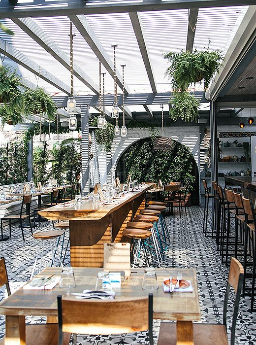 The Outpost has an airy indoor-outdoor vibe, with arched doorways and plenty of lush greenery. Photo courtesy of The Outpost.