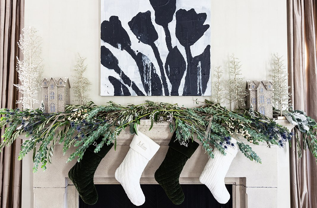 This mantel look is all about sparkle, shine, and high glamour, incorporating a mix of florals and greenery with a few special metallic accents.