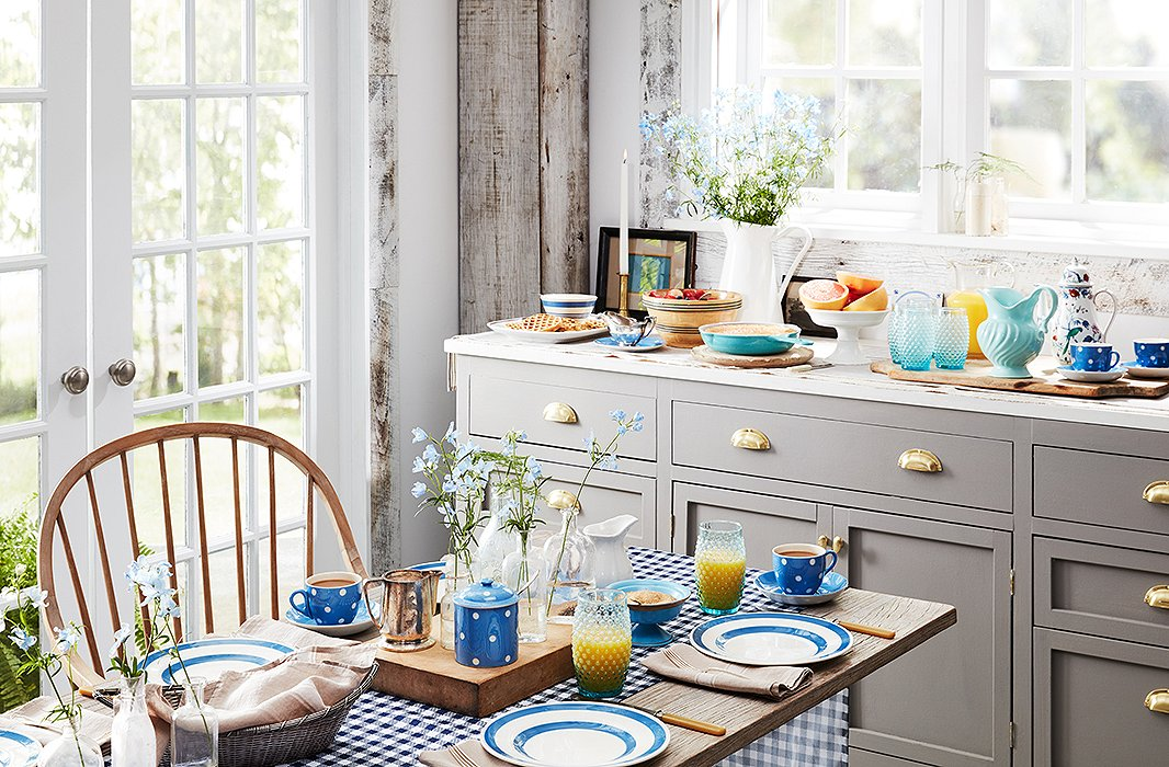A simple table setting in a spectrum of blue hues sets a cheerful tone.