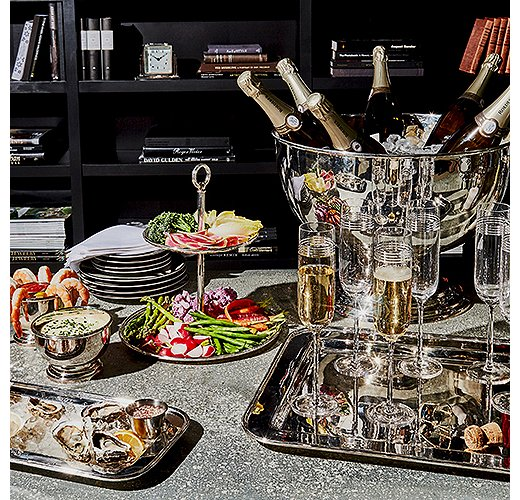 A New Year's Eve-worthy spread, made all the more celebratory by the gleam of polished silver serveware.